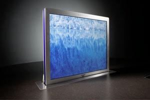 CONVERSE 190, per Knopfdruck fährt der Monitor lautlos senkrecht aus dem Möbel und verschnwindet nahezu spurlos wieder in der Oberfläche.